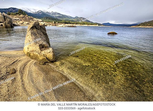 Burguillo reservoir and Sierra de Gredos on a cloudy day. Avila. Spain. Europe