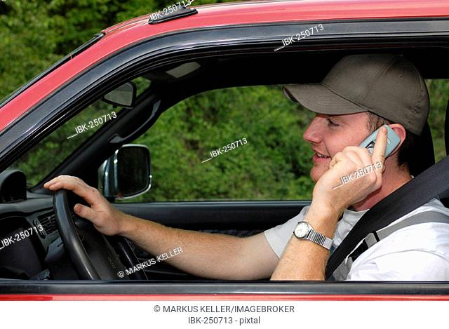 Cardriver with telephone, Germany, Europe