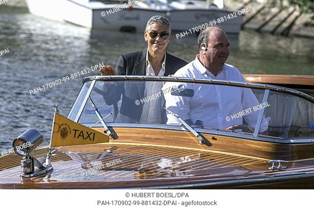 George Clooney and driver Sandro depart by boat during the 74th Venice Film Festival at Hotel Excelsior in Venice, Italy, on 01 September 2017