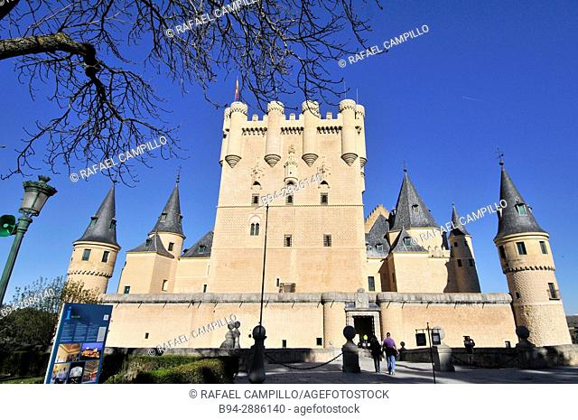 Alcazar. View of the Castle from the entrance to the monument and drawbridge, Juan II Tower, rising out on a rocky crag, built in 1120, Segovia, Castilla y Leon