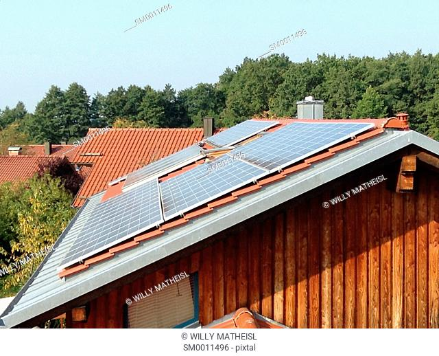 solar pannels on a rooftop of a wooden family house, Bavaria, Germany, Europe