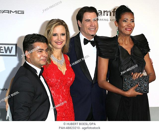 Italian fashion agent Oscar Generale (L), US actress Kelly Preston, US actor John Travolta and Dominican-born Danny Mendez attend the Cinema Against AIDS amfAR...