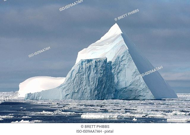 Iceberg in ice floe in the southern ocean, 180 miles north of East Antarctica, Antarctica
