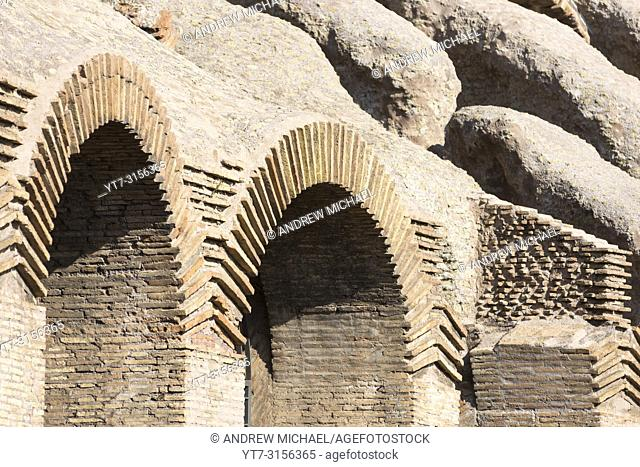 Interior walls and arches of the Colosseum or Coliseum, also known as the Flavian Amphitheatre, an oval amphitheatre in the centre of the city of Rome