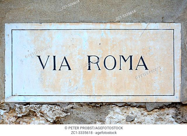 Street sign of the street Via Roma in the historic centre of Verona - Italy