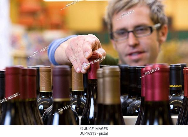 Man choosing a bottle of wine