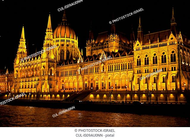 Hungarian Parliament at night, Danube River in foreground, Budapest, Hungary