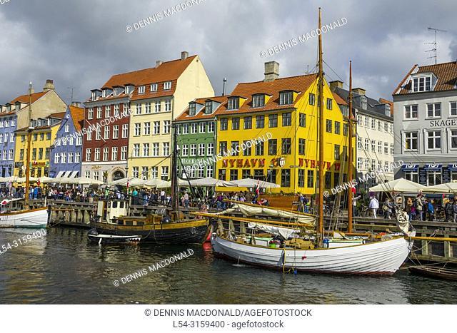 Nyhavn Copenhagen Cafes bars restaurants on the historic Nyhavn canal district Copenhagen Denmark capital city