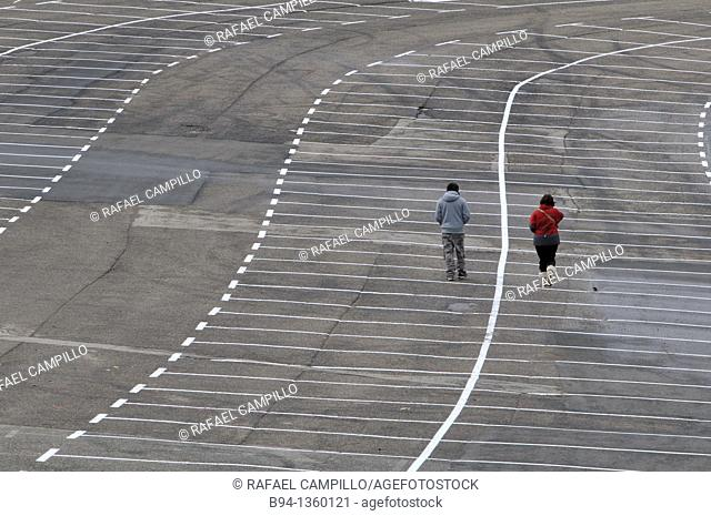 Couple walking in empty parking, La Molina ski resort, Girona province, Catalonia, Spain