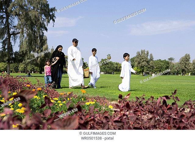 Parents with children having picnic at park