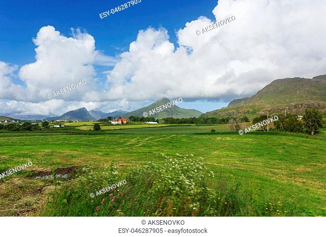 Typical scandinavian landscape with meadows, mountains and village. Lofoten islands, Norway