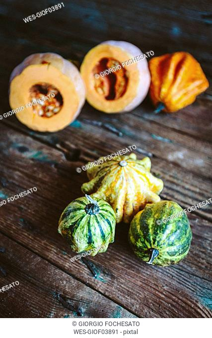 Various ornamental pumpkins on wood