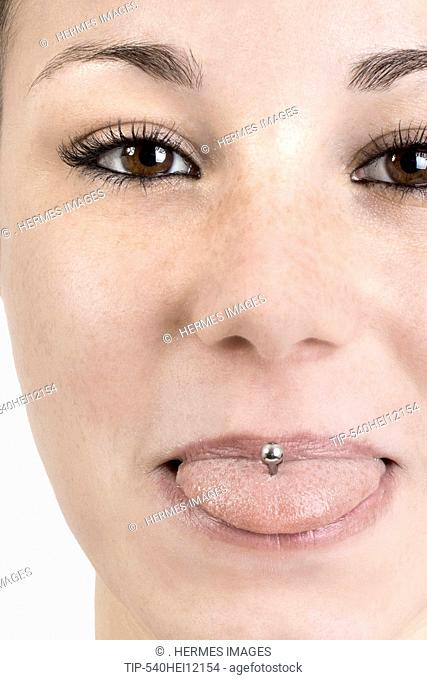 Woman with tongue piercing