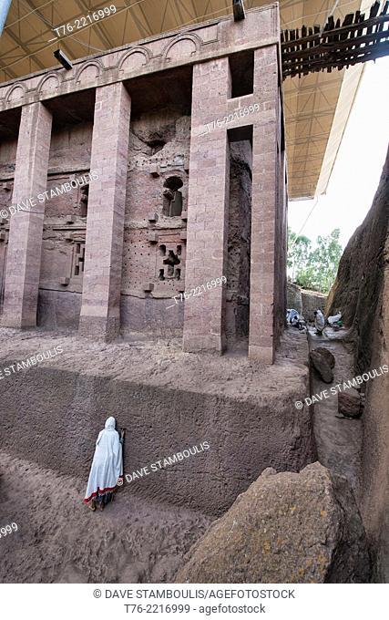 pilgrim praying at Bet Medhane Alem rock hewn church in Lalibela, Ethiopia