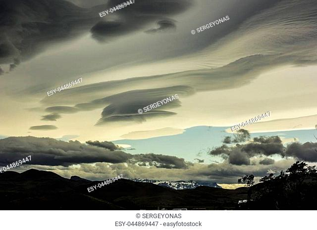 grey lenticular clouds above snowy mountains in Patagonia chili, torres del payne