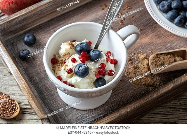 Cottage cheese with ground flax seeds, blueberries and frozen cranberries