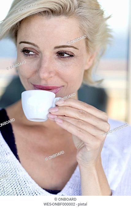 Mature woman with a cup of coffee