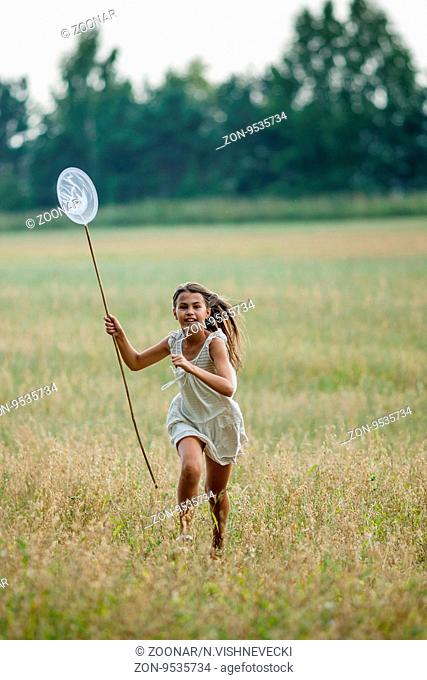 girl running with butterfly net over a butterfly