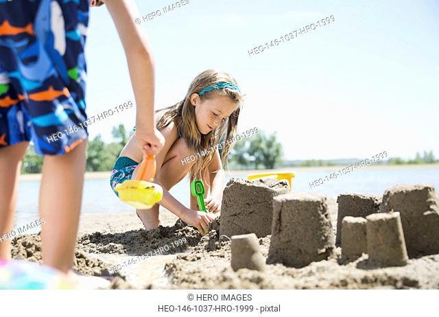 Kids making sandcastles on the beach