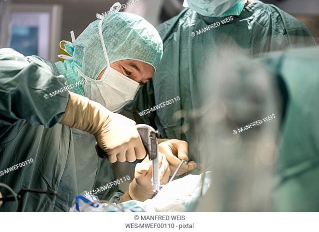 Neurosurgeons opening the cranium during an operation