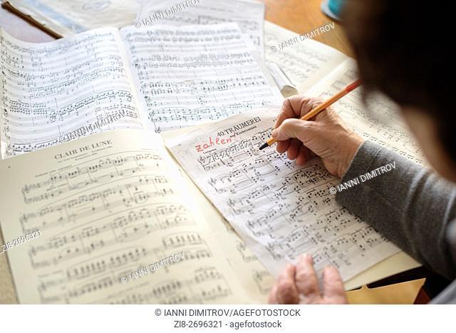 Musician teacher reading music scores