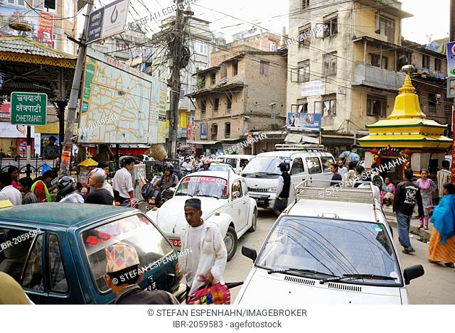 Street scene, dense traffic, pedestrians and cars, junction in the Thamel district, Kathmandu, Nepal, Asia
