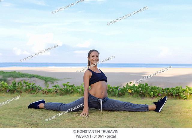 Indonesia, Bali, woman stretching