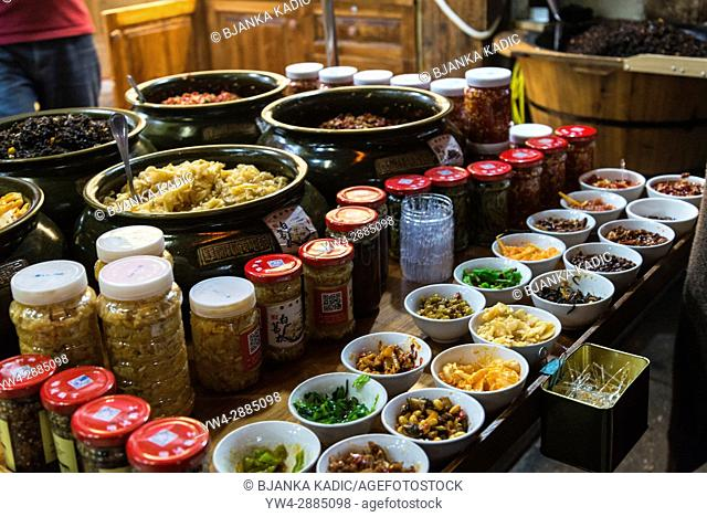 Local food delicacies sold in the street, Tunxi Old Street, traditional shopping hub, Huangshan, Anhui province, China