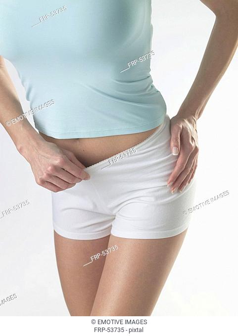 Woman wearing white shorts