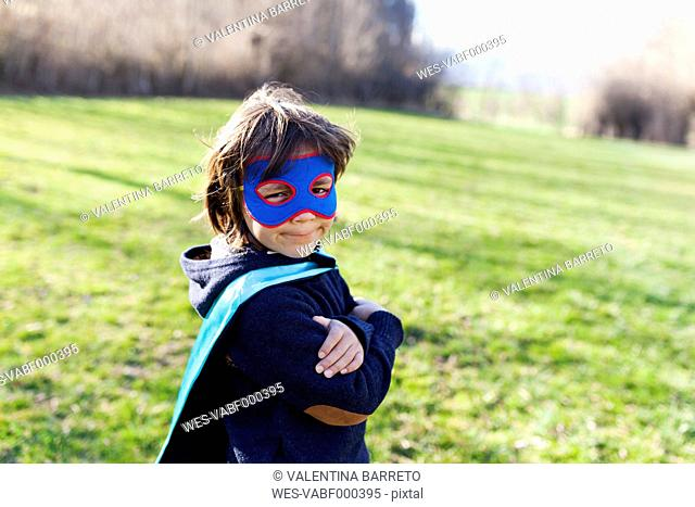 Portrait of little boy dressed up as superhero