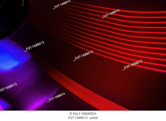 Full frame abstract image of red light trails