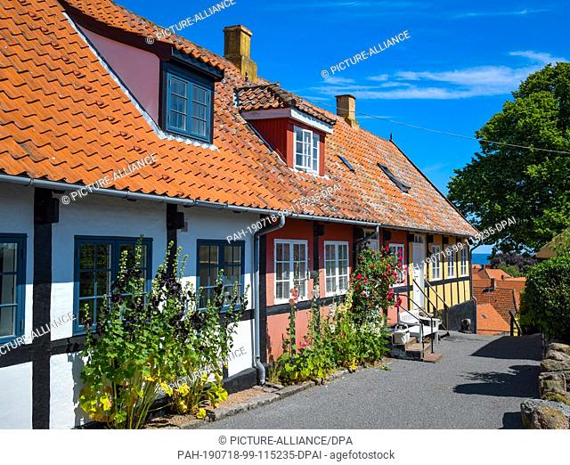 28 June 2019, Denmark, Svaneke: Typical residential buildings in Svaneke, a small town on the north-eastern edge of the Danish Baltic Sea island of Bornholm