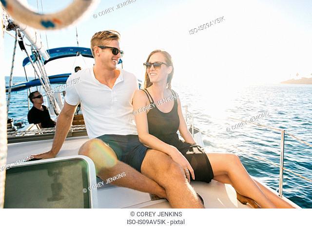 Couple chatting on sailboat, San Diego Bay, California, USA