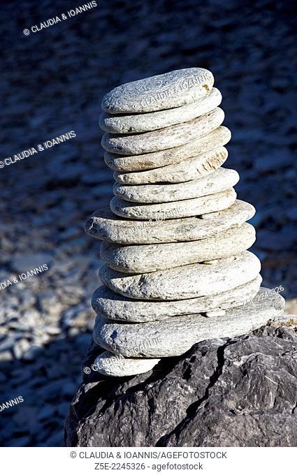 Stacked stones on pebble beach