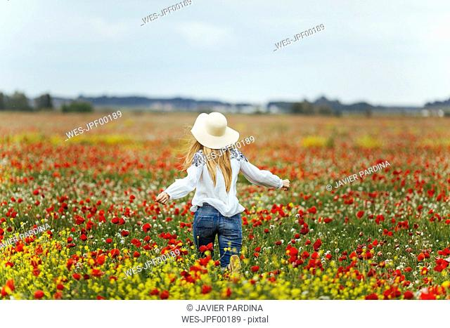 Woman walking in a flower field