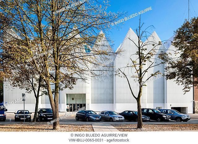 Public square with car park and philharmonic hall beyond. Szczecin Philharmonic Hall, Szczecin, Poland. Architect: Estudio Barozzi Veiga, 2014