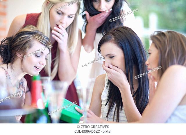 Female friends giving birthday gift