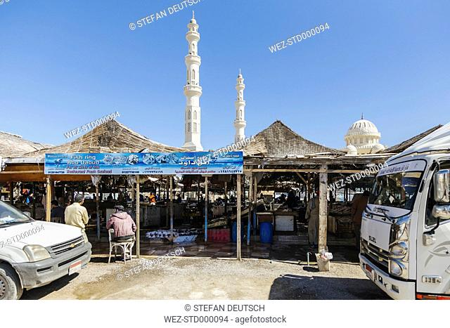 Egypt, Hurghada, view to fish market with minarets and cupola of El Mina Mosque in the background