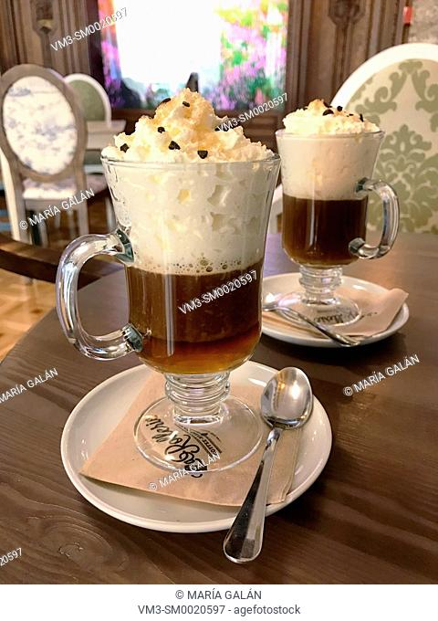 Two glasses of Irish coffee in a cafe