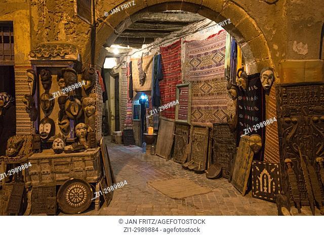 small shops in street at dusk in Essaouira, Maroc