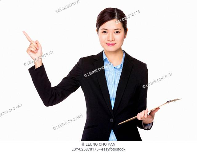 Young businesswoman hold with clipboard and finger point up
