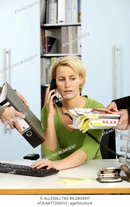Woman getting work from all sides