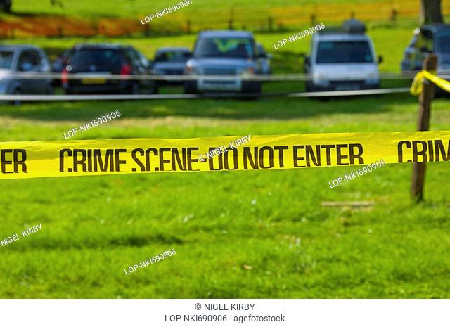 England, North Yorkshire, -, Police tape with the words CRIME SCENE-DO NOT ENTER used to seal off an area