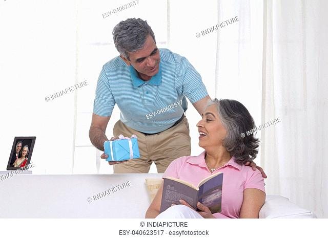 Husband giving a gift to his wife