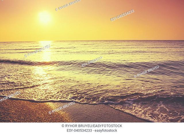 Soft Sea Ocean Waves Wash Over Golden Sand Background. Sunset, Sunrise, Sun. Toned like instant photo