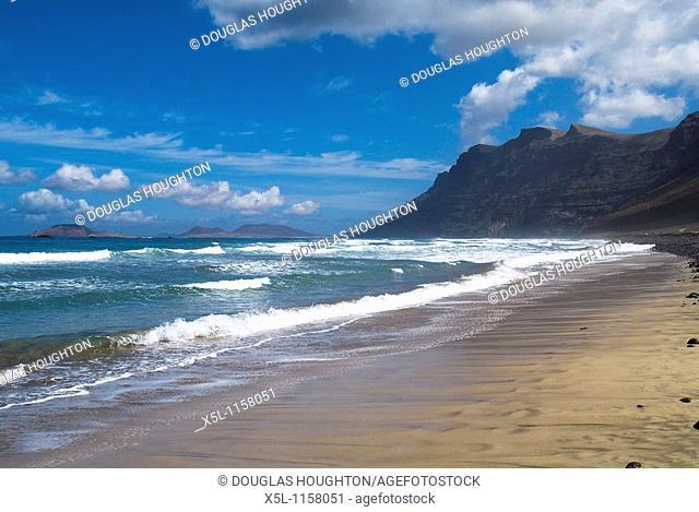 Playa de Famara FAMARA LANZAROTE Surf waves sandy beach El Risco de Famara sea cliffs and bay
