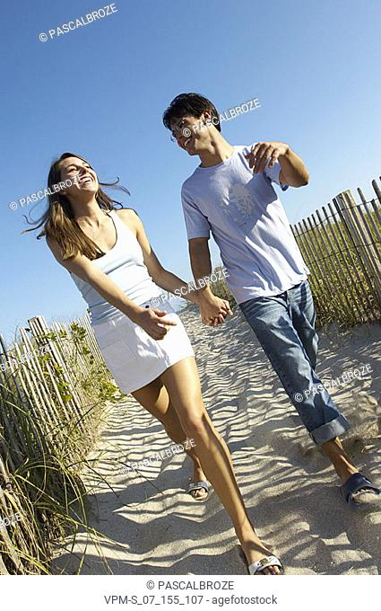 Young couple walking on a dirt road