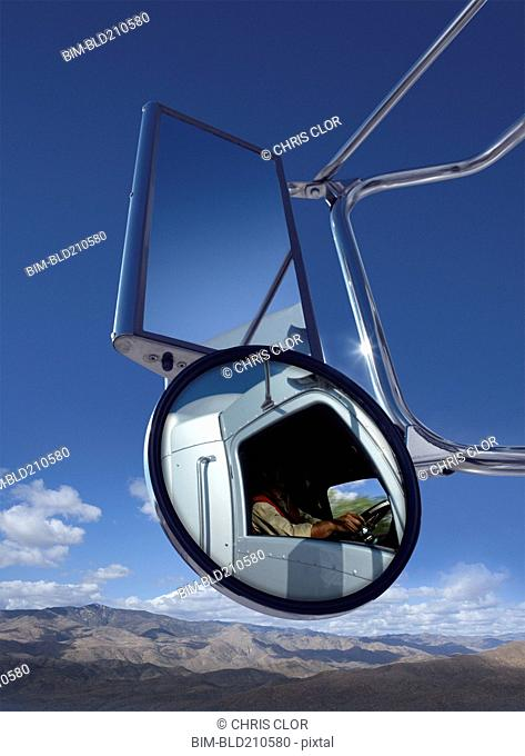 Trucker reflected in side mirror
