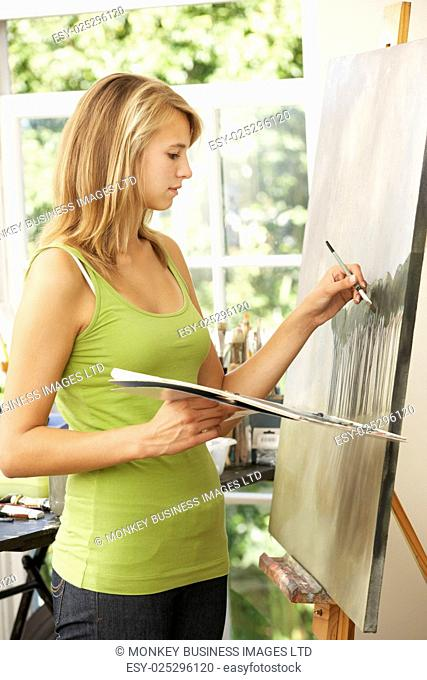 Teenage Girl Working On Painting In Studio