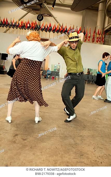 An older woman and young hipster, an odd couple, dance at the National World War Two Museum, during the music tribute to the 1940's